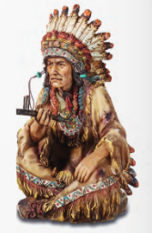 Indian chief seatted peace pipe